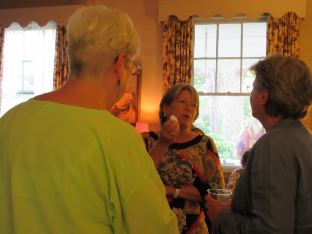 Nan Chase Board Member Friends of the NC Room talking with Lynne and Zoe. Nan is the author of Asheville: A History and has just started a book tour for her just published book, Drink the Harvest.
