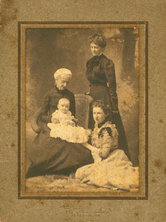 Photograph circa 1904 of Josie Buel Patton, wife of Haywood Parker (Mary Parker's parents) sitting on floor next to her second-born child, Thomas Patton Parker who only lived one year. Josie's mother Martha Turner Patton, wife of Thomas Walton Patton, stands on right.