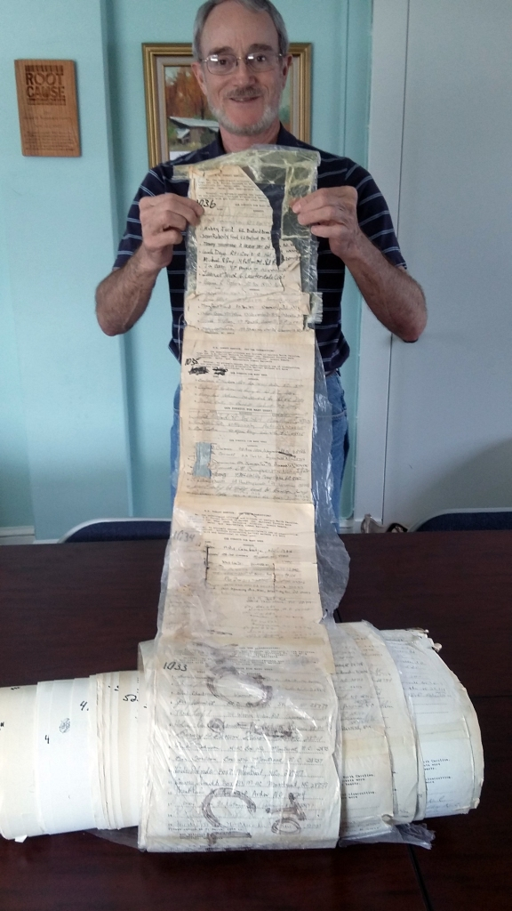 Photo of Bob Gale of MountainTrue holding the 1989 WNC Alliance petition against clear-cutting. O161-DS